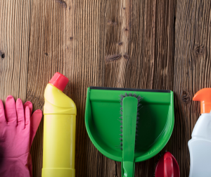 Spring cleaning materials on wooden background - virtual viewings